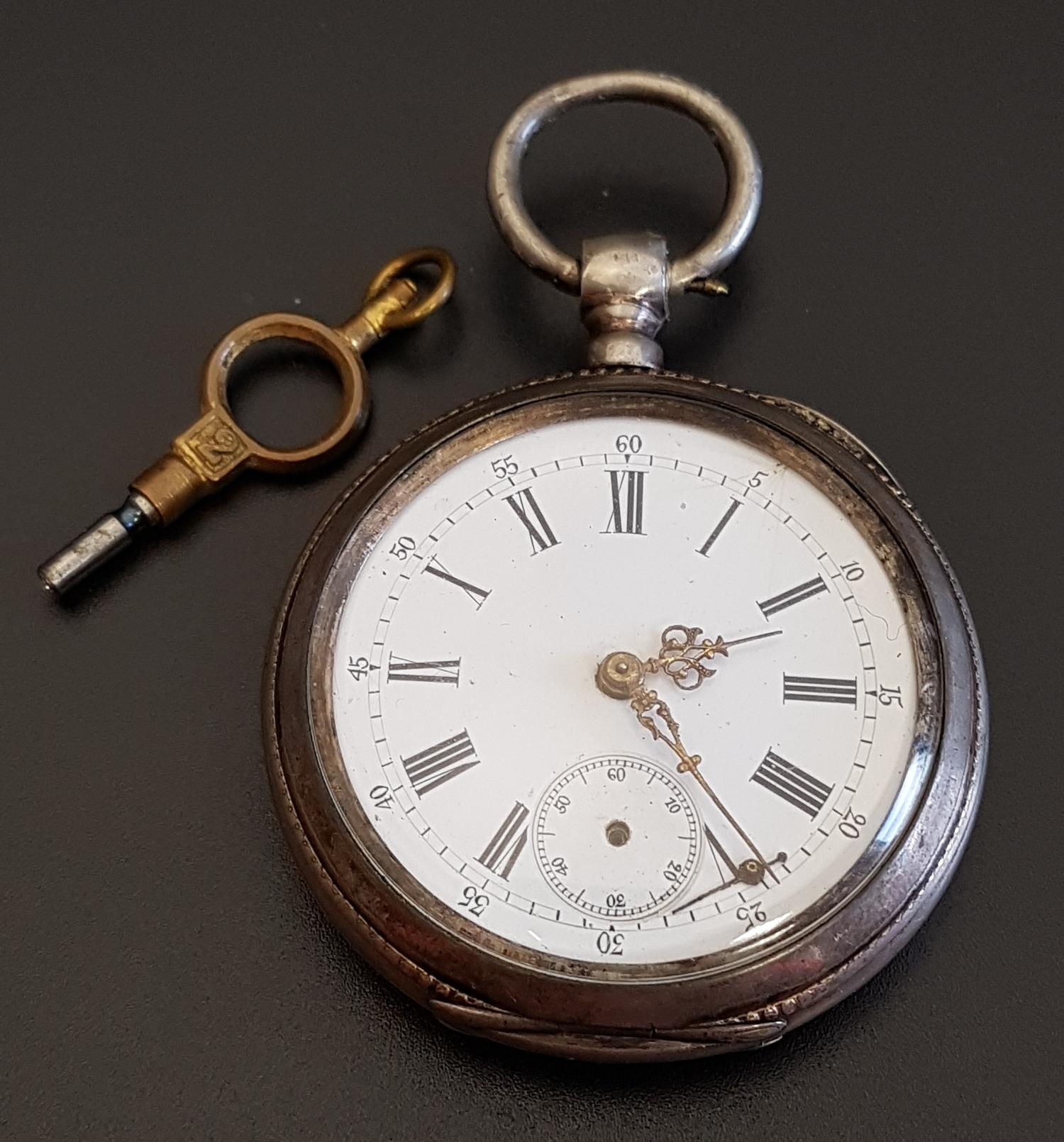 Lot 63 - FRENCH SILVER CASED POCKET WATCH the white enamel dial with Roman numerals and subsidiary seconds