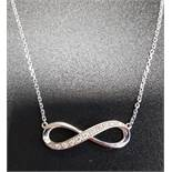 DIAMOND SET INFINITY SYMBOL PENDANT in nine carat white gold and on attached nine carat white gold