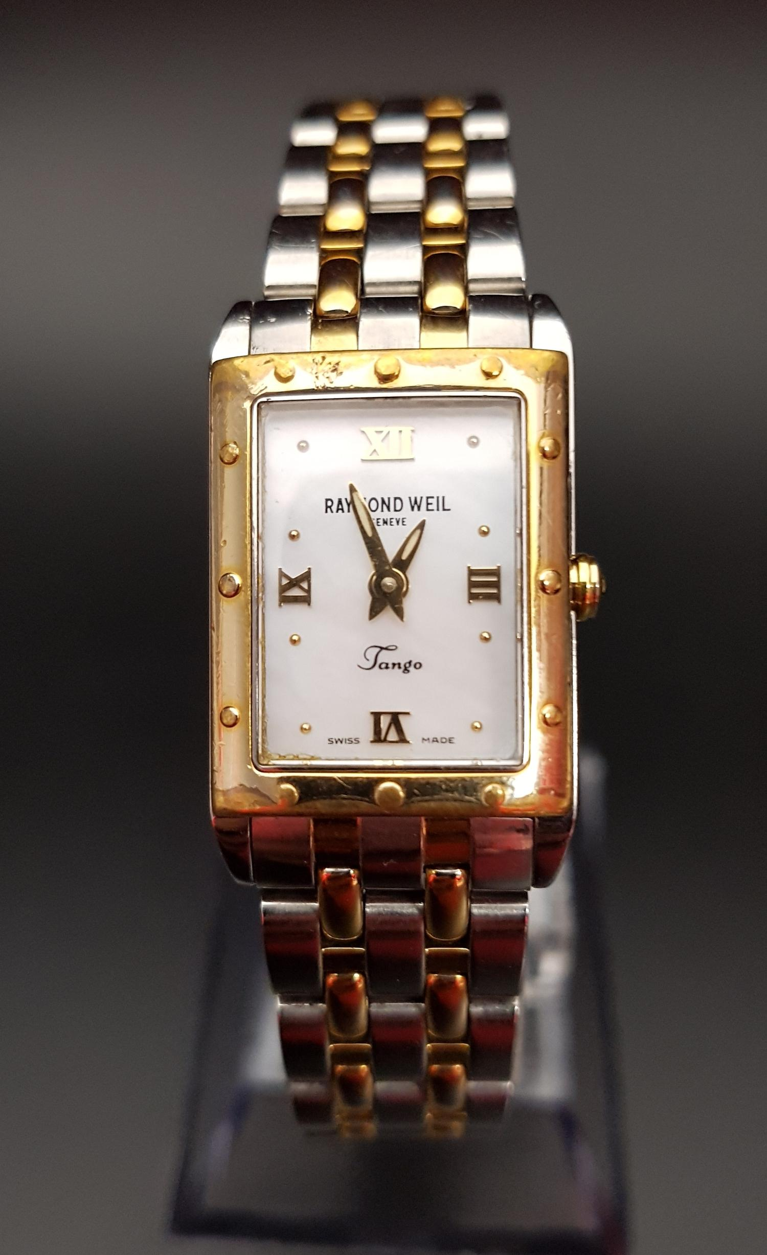 Lot 102 - LADIES RAYMOND WEIL TANGO COLLECTION WRISTWATCH the mother of pearl dial with Roman numerals at
