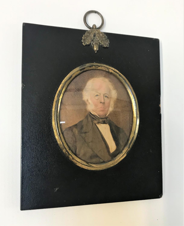 Lot 287 - WATERCOLOUR MINIATURE PORTRAIT OF A GENTLEMAN the oval portrait in rectangular frame, miniature size