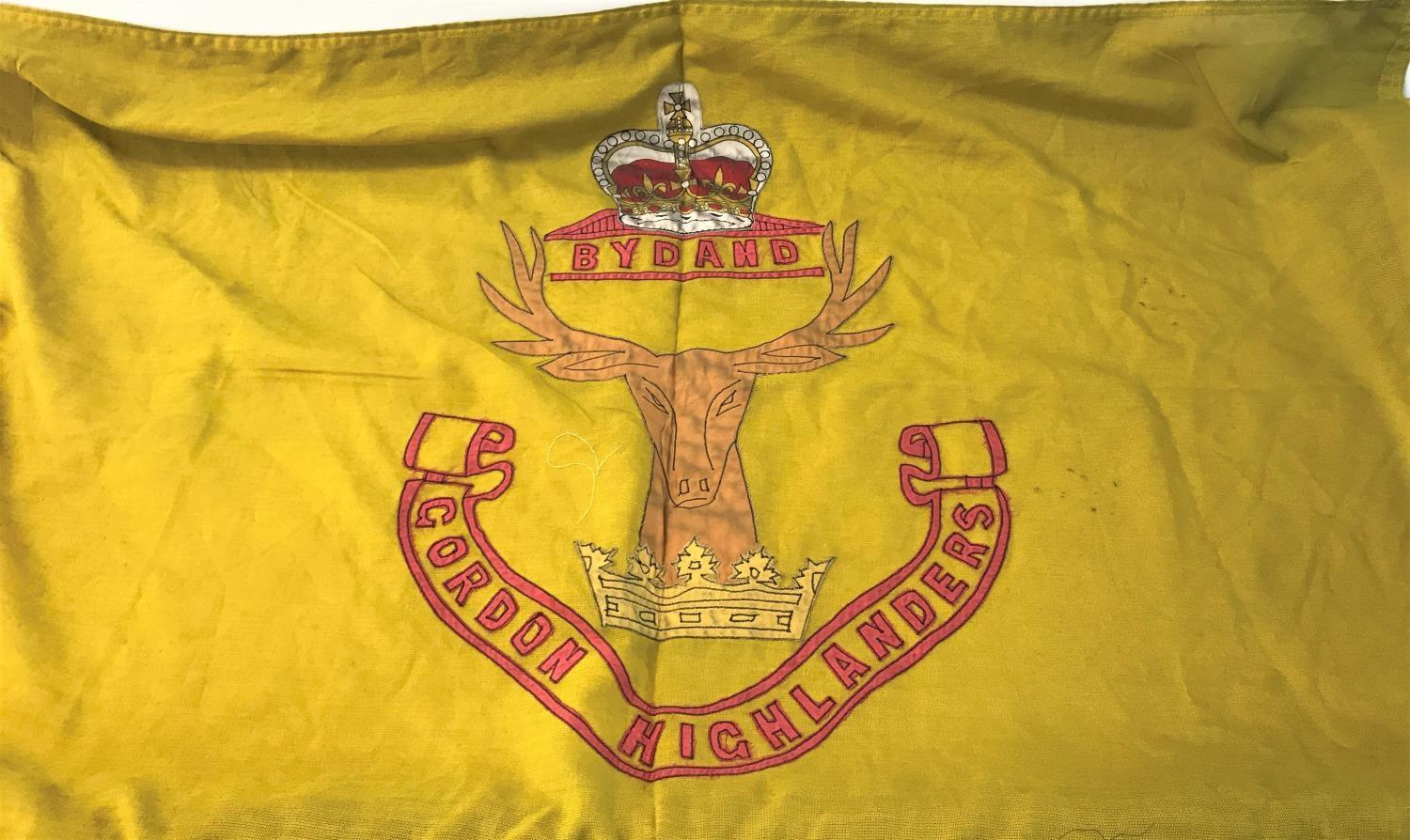 Lot 285 - VINTAGE LINEN GORDON HIGHLANDERS FLAG the yellow flag with regimental badge, 75cm x 125cm
