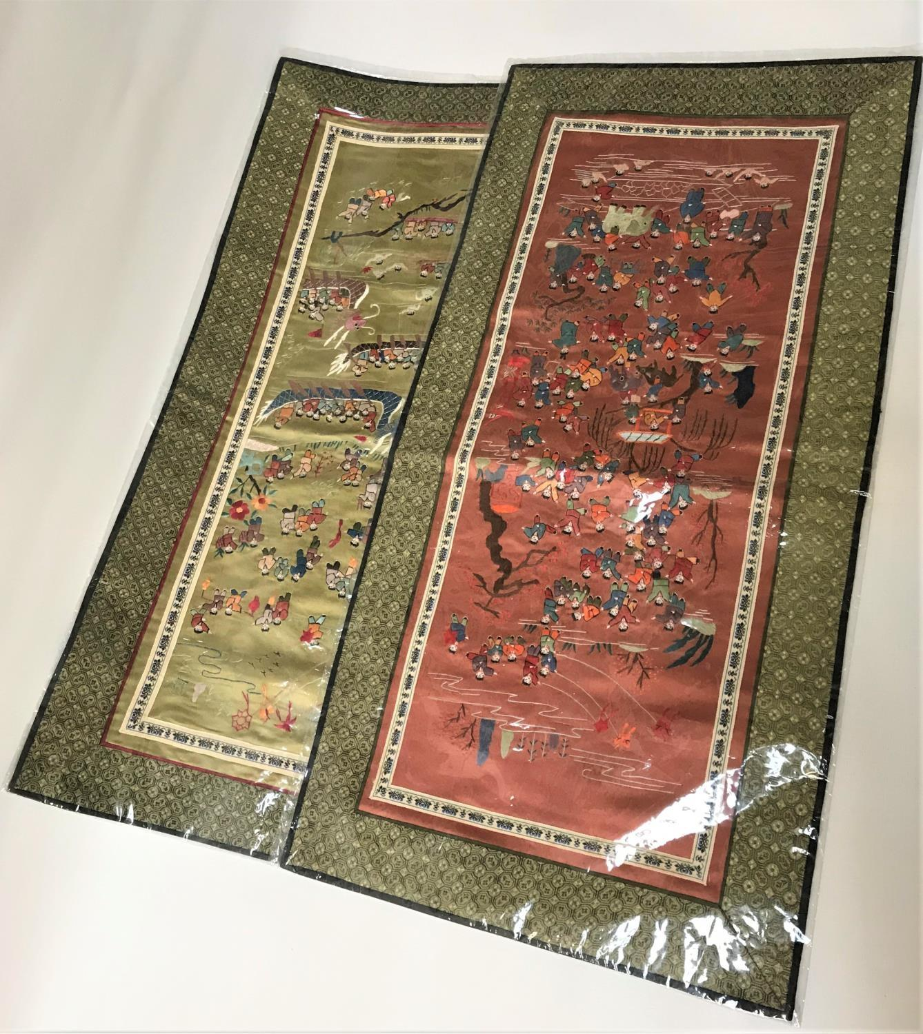 Lot 262 - TWO CHINESE EMBROIDERED SILK PANELS depicting figures in colourful dress performing various