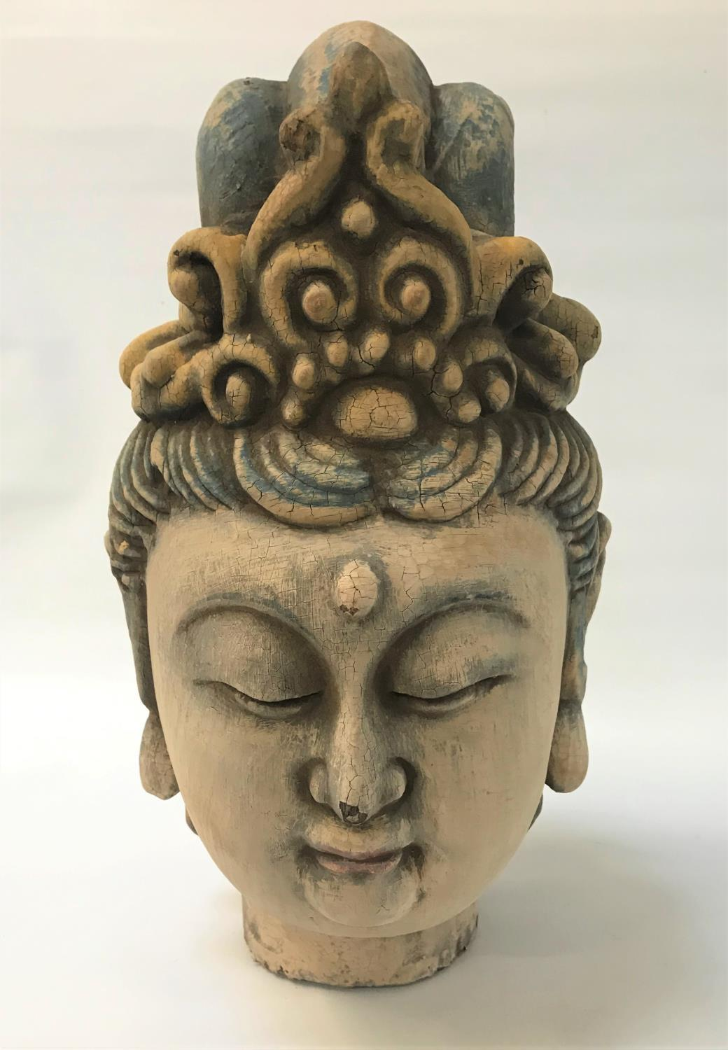 Lot 288 - CARVED POLYCHROMED HEAD OF GUANYIN with a serene expression, eyes closed and mouth relaxed,