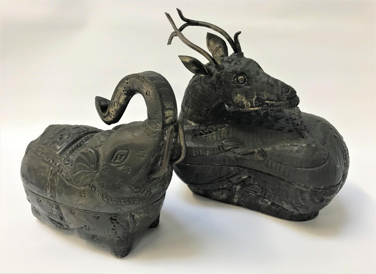 Lot 291 - TWO INDIAN BEETLE NUT BOXES in white metal, one depicting a recumbent deer, 17cm long; the other