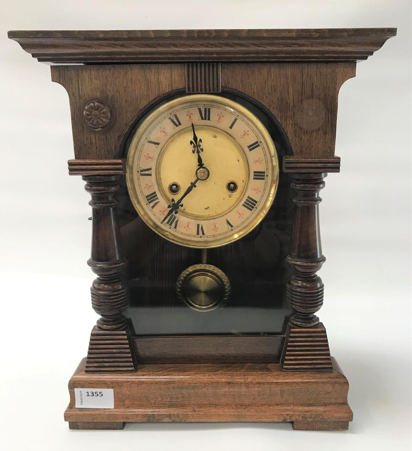 Lot 245 - GERMAN H.A.C. OAK MANTLE CLOCK with a circular dial with Roman numerals and an eight day movement,