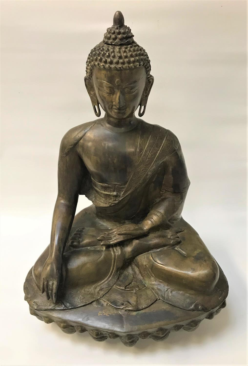 Lot 293 - 19TH CENTURY BRONZE BUDDHA SHAKYAMUNI seated with legs crossed with one hand across his lap with the