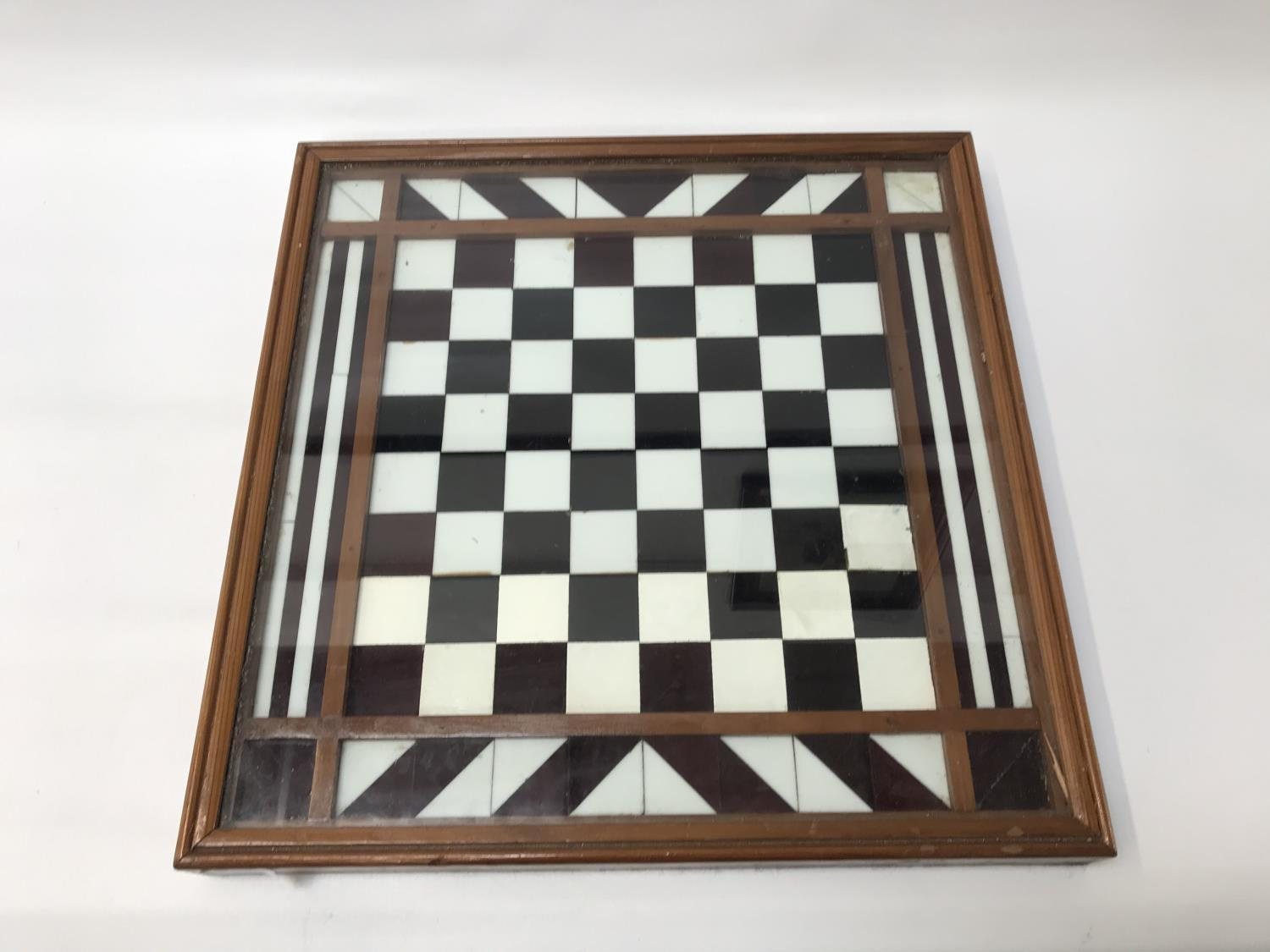 Lot 252 - TABLE TOP CHESS BOARD in a mahogany frame under glass, 45.5cm x 45.5cm