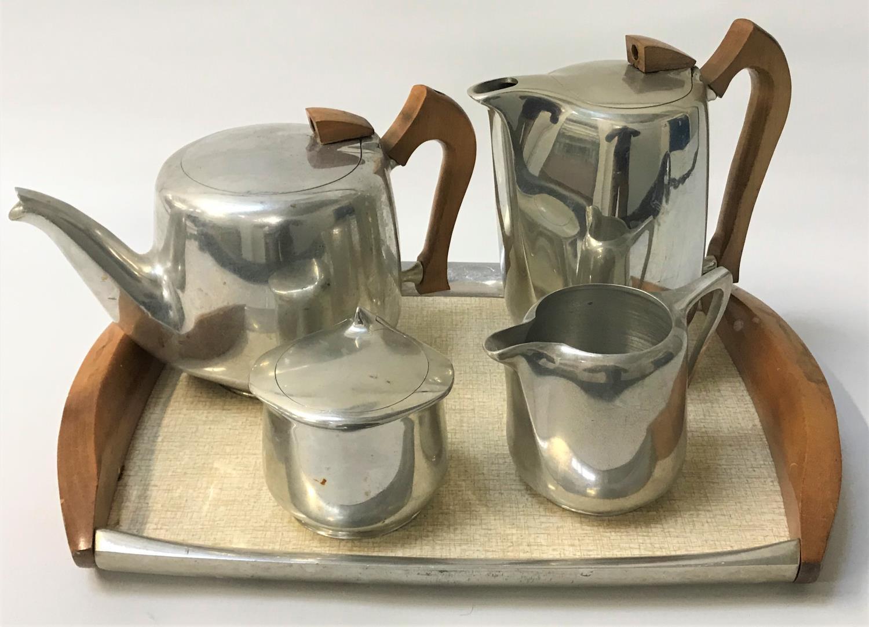 Lot 265 - PICQUOT WARE STAINLESS STEEL TEA SET comprising a tea pot, hot water jug, lidded sugar bowl, milk