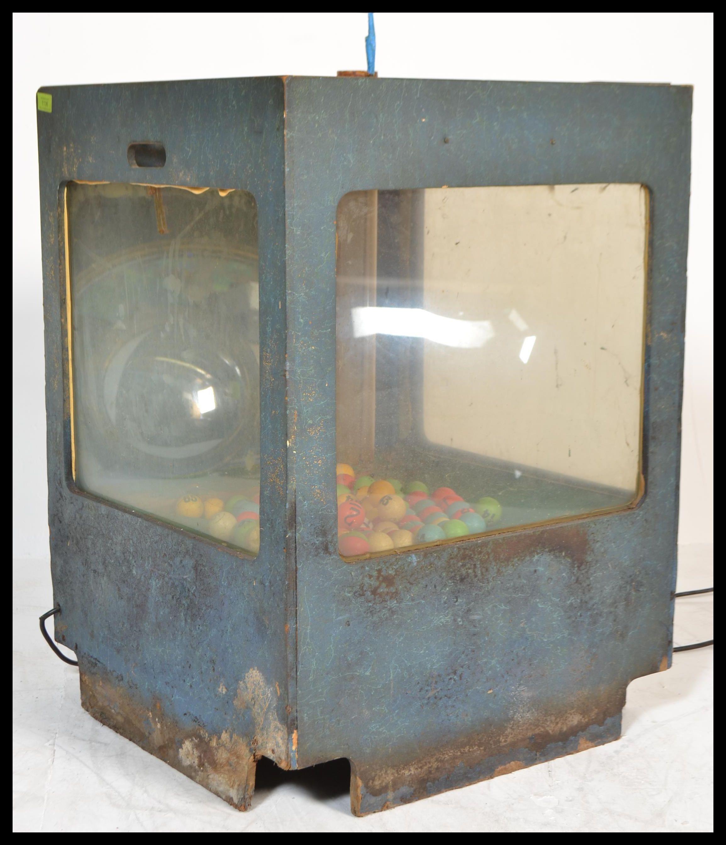 A vintage retro 20th century bingo tombola lottery machine having a