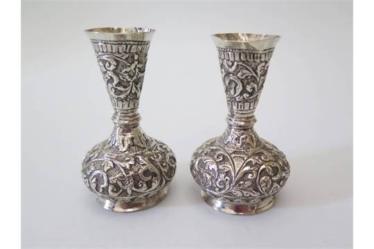 A Small Pair Of Indian Silver Vases Decorated With Scrolling Foliate