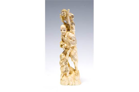 A Japanese ivory tusk carving okimono of a farmer with two infants