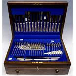 An Elizabeth II silver Old English and Beaded pattern eight piece flatware service,