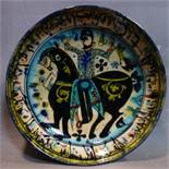 A Persian glazed ceramic bowl, decorated with a figure on horseback, date and mark to base, H.7cm