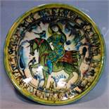 A Persian glazed ceramic bowl, decorated with a lady on horseback, dated and marked to base, H.6.5cm