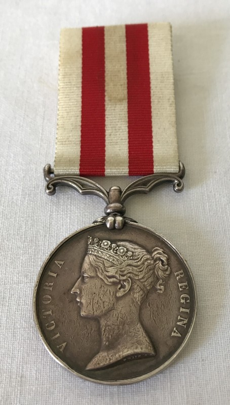 Lot 1 - An Indian Mutiny medal.