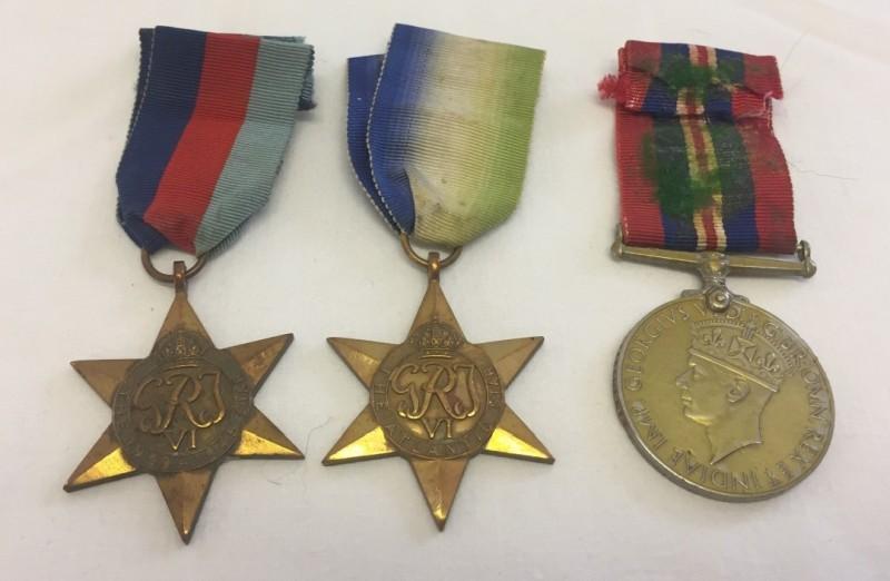 Lot 11 - WW2 trio.