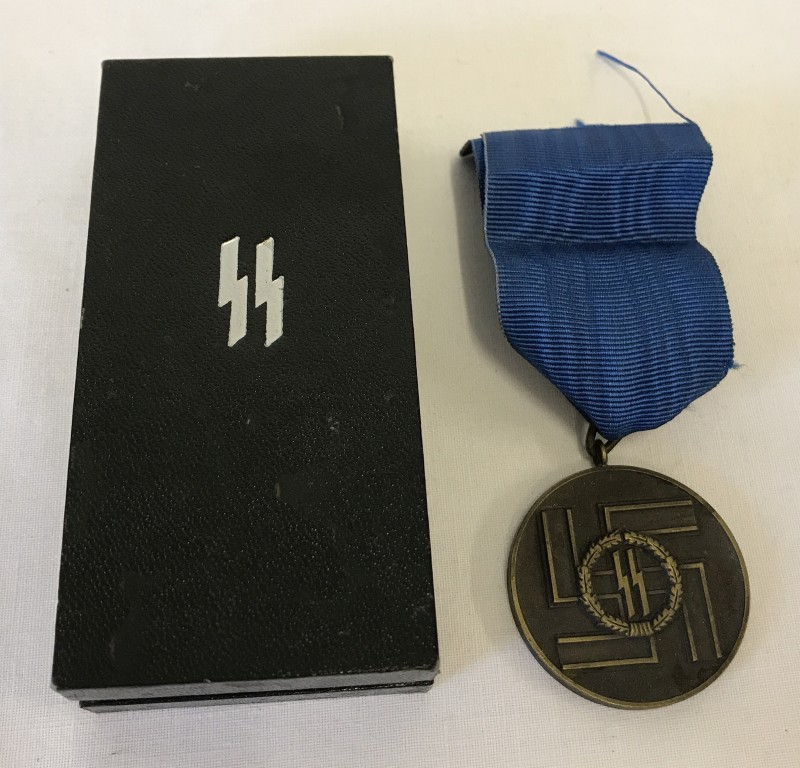 Lot 136 - A boxed German SS 8 Year long service & good conduct medal.