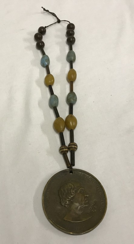 Lot 139 - American Red Indian Wars President Johnson Peace medal on beaded rope.