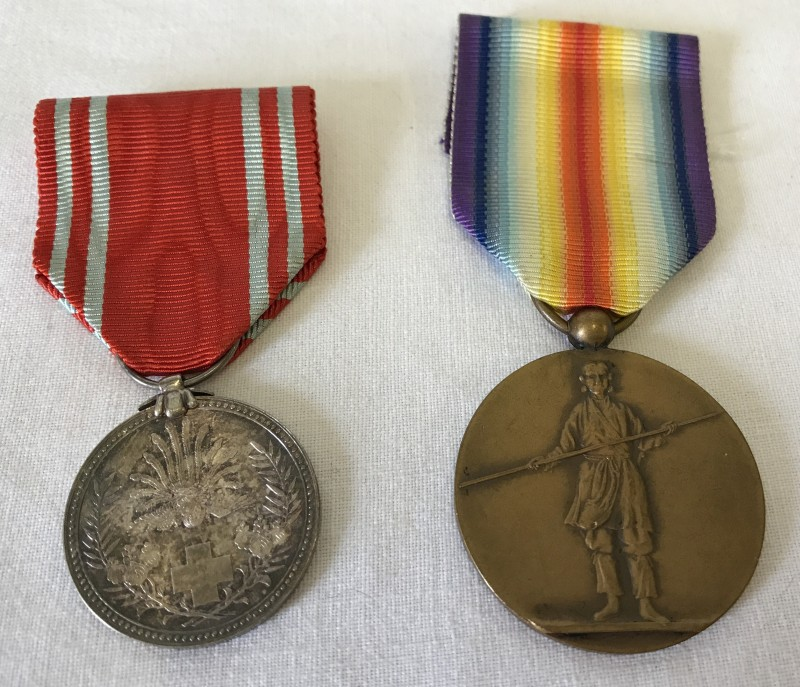Lot 81 - A scarce Japanese WWI Victory medal together with a Red Cross Service medal.