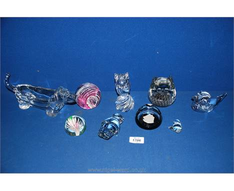 A quantity of glass paperweights including Cristallerie Lorraine duck and owl, Holmegaard eskimo, Phoenician pink and white s