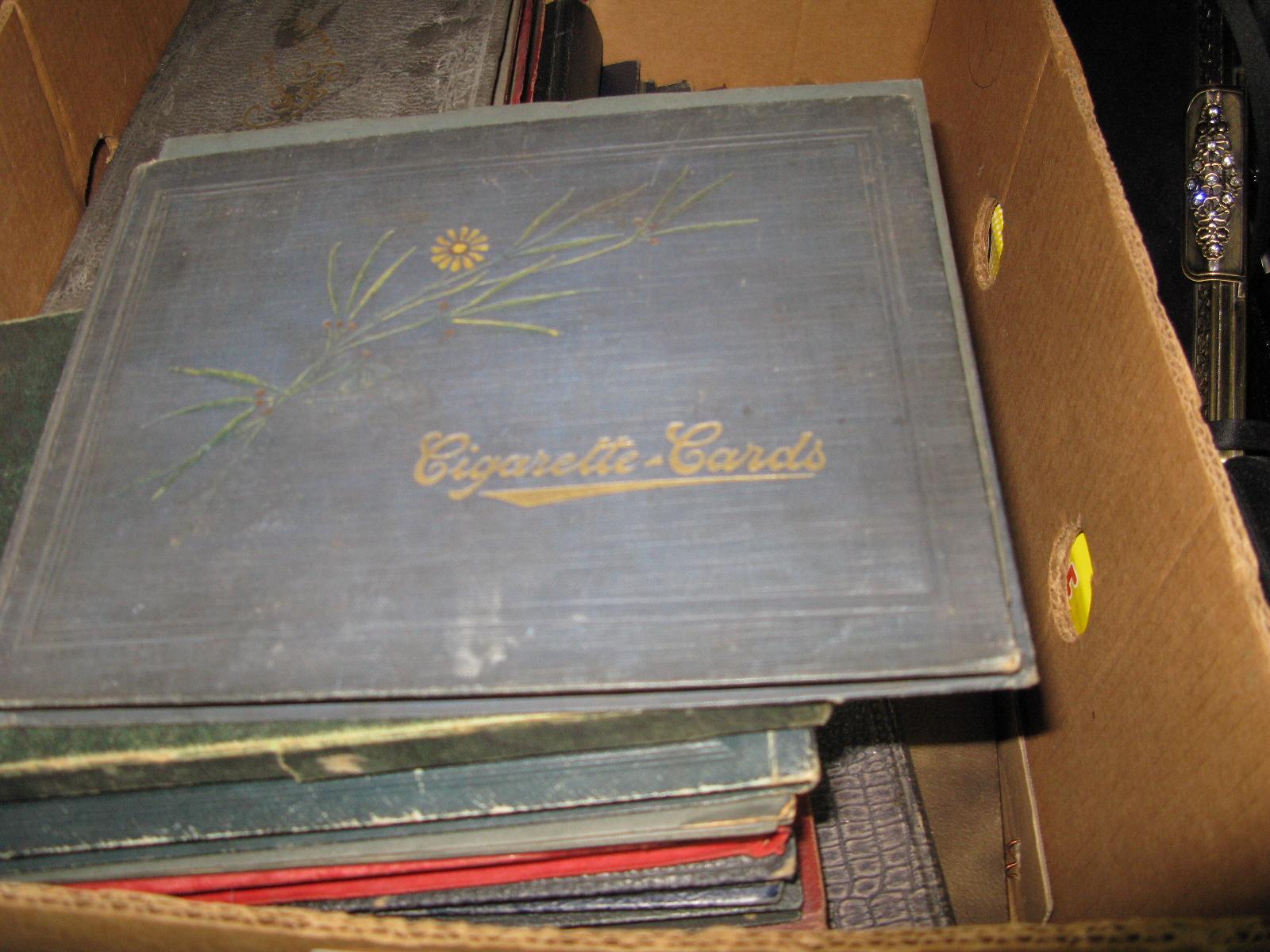Lot 1023 - Twenty-One Vintage Empty Cigarette Card Albums.