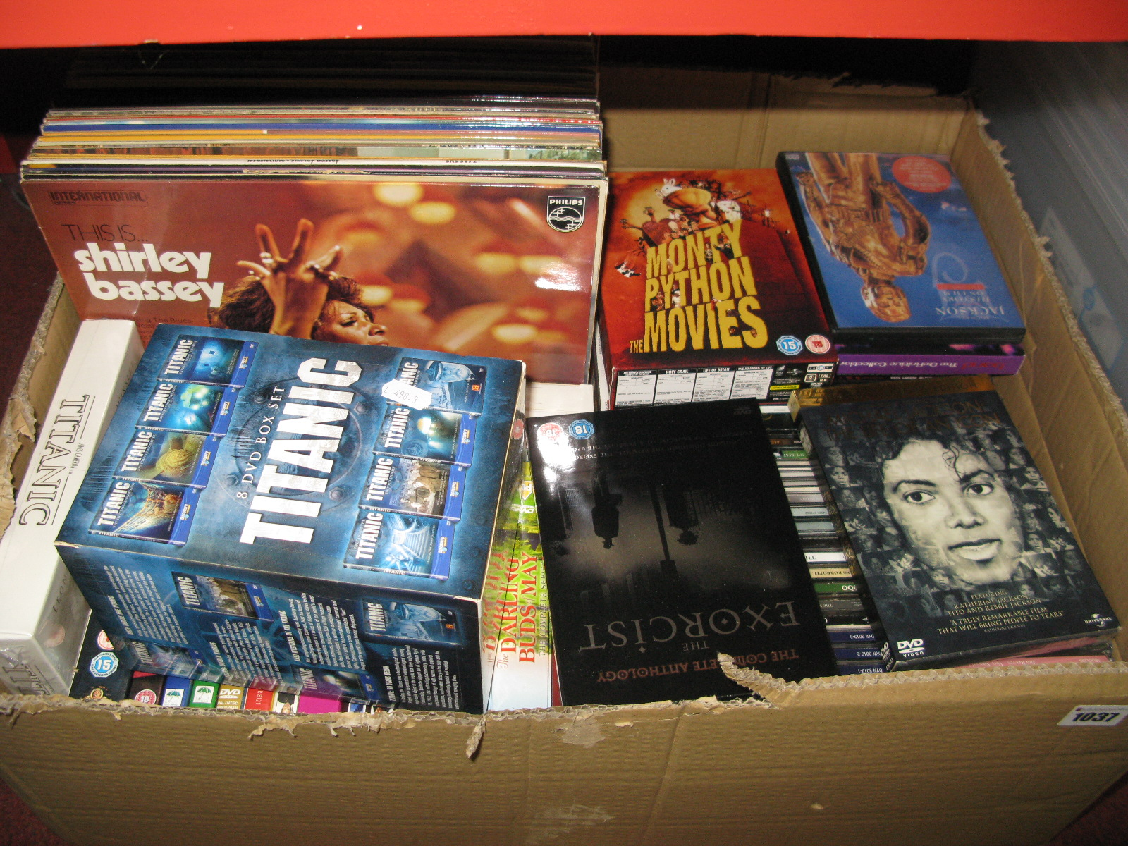 Lot 1037 - A Quantity of DVD's, CD's, (modern titles noted), LP's, etc:- One box and three storage tubs. (4)