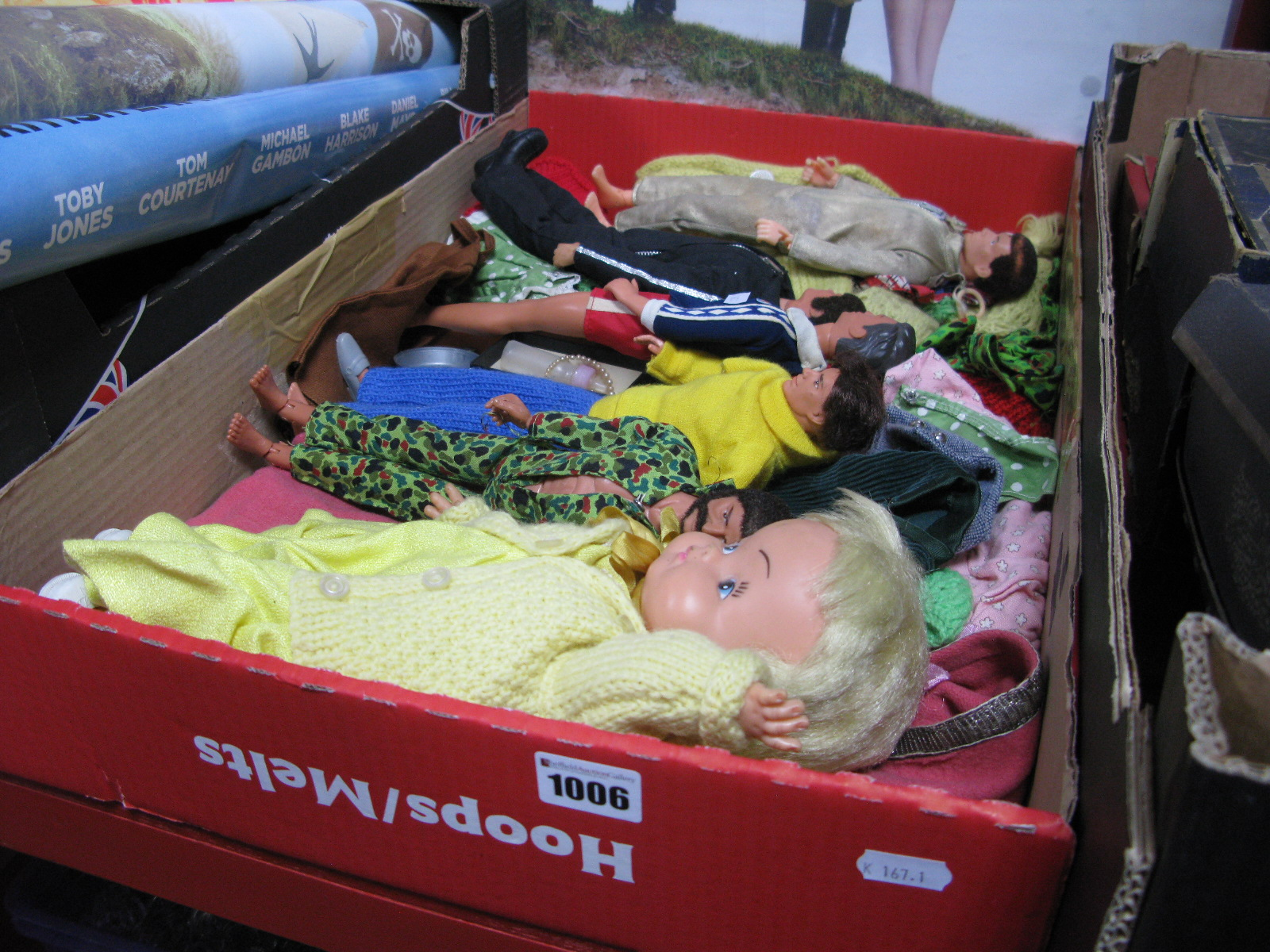 "Lot 1006 - A Quantity of 12"" Action Figures and A Doll, plus associated clothing, all playworn."