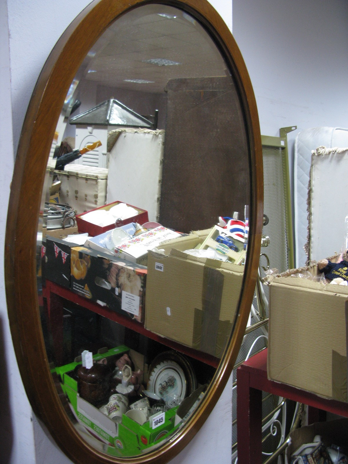 Lot 1045 - An Edwardian Inlaid Mahogany Framed Oval Bevelled Wall Mirror; two others. (3)