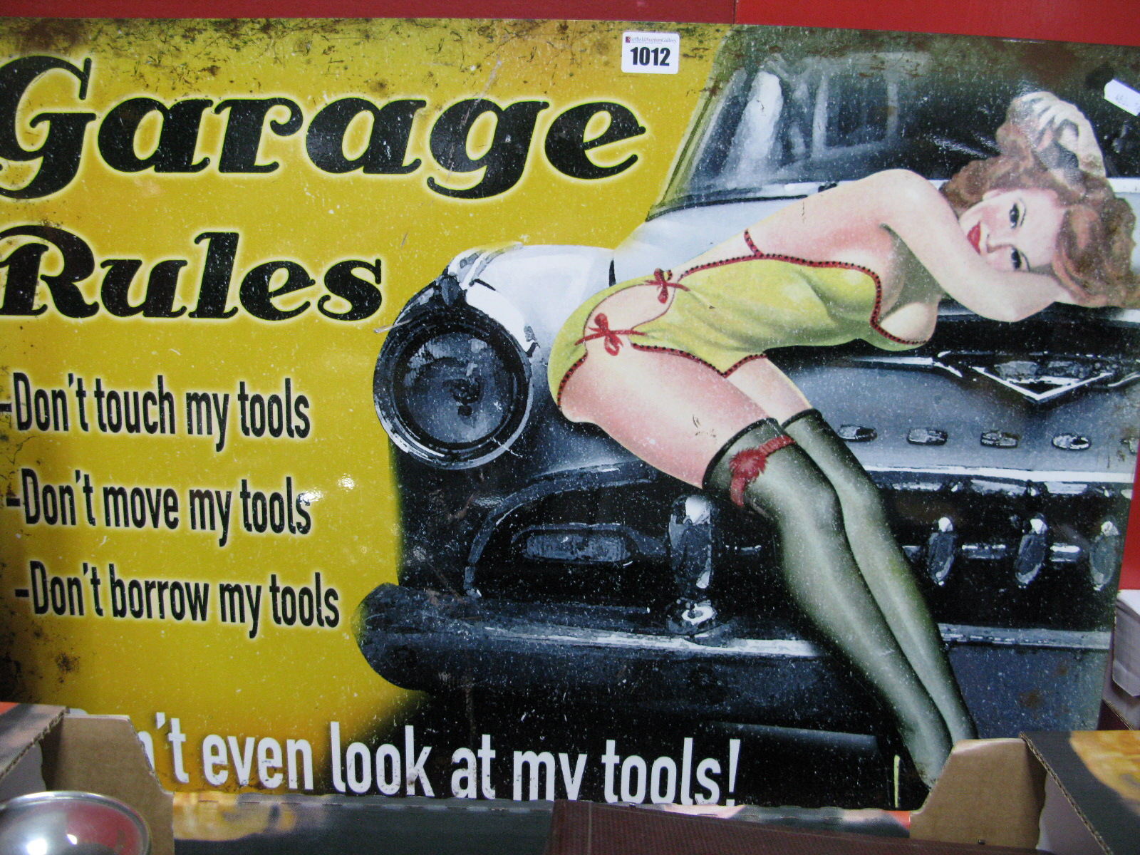 """Lot 1012 - A Metal Wall Sign Advertising """"Garage Rules"""", 50 x 70cm."""