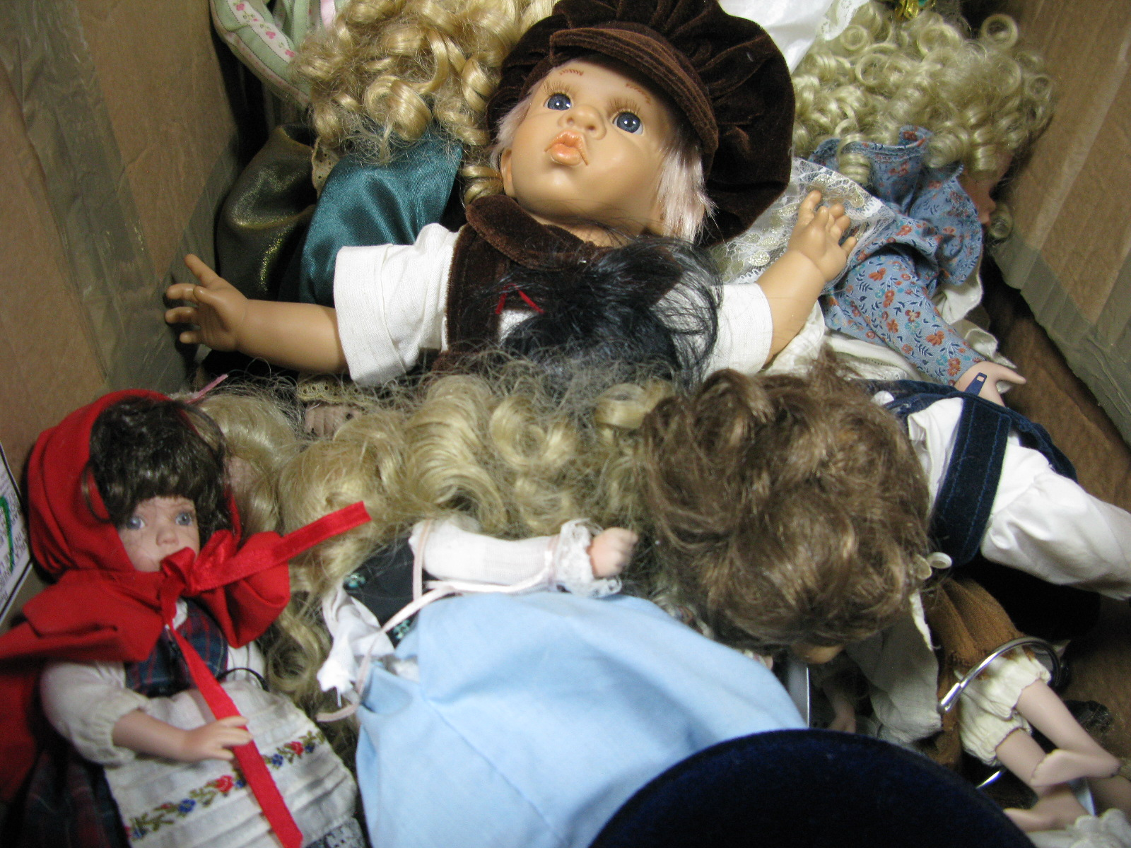 Lot 1015 - A Quantity of Dolls, including pottery headed examples; together with display rack.