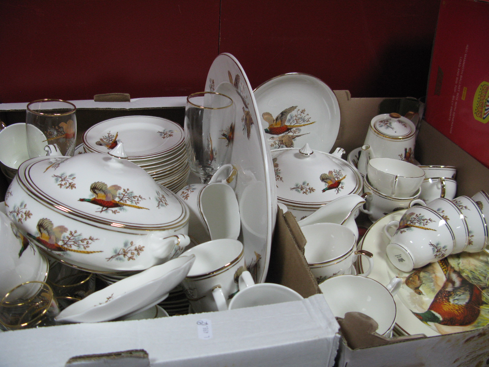 Lot 1010 - A Large Sheridan China Tea and Dinner Service, printed with pheasants on a white ground (