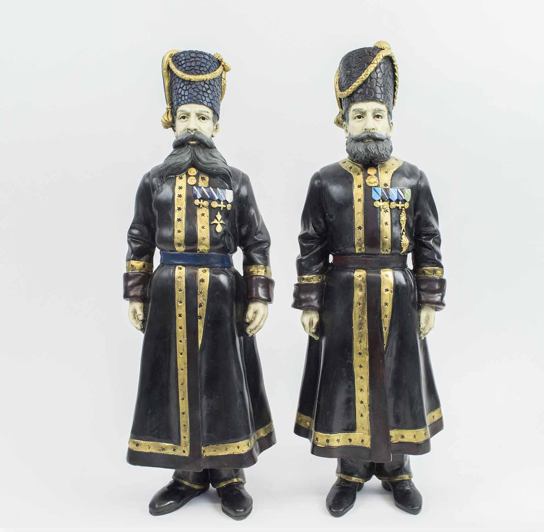 FABERGE MANNER BRONZE COSSACKS, a pair, Pustynnikov chamber Cossack 1894,