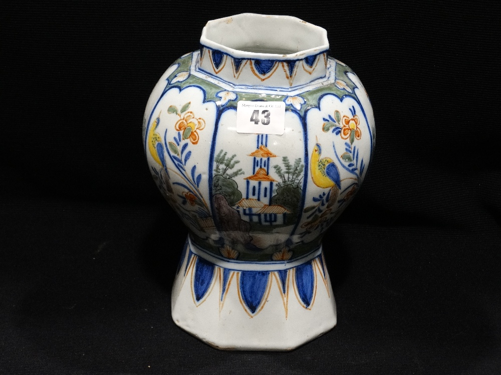 "Lot 43 - An Octagonal Based Delft Pottery Vase With Bird Floral & Landscape Panels, 9"" High"
