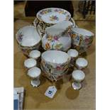 A Twenty-Eight Piece New Chelsea China Floral Decorated Tea Set