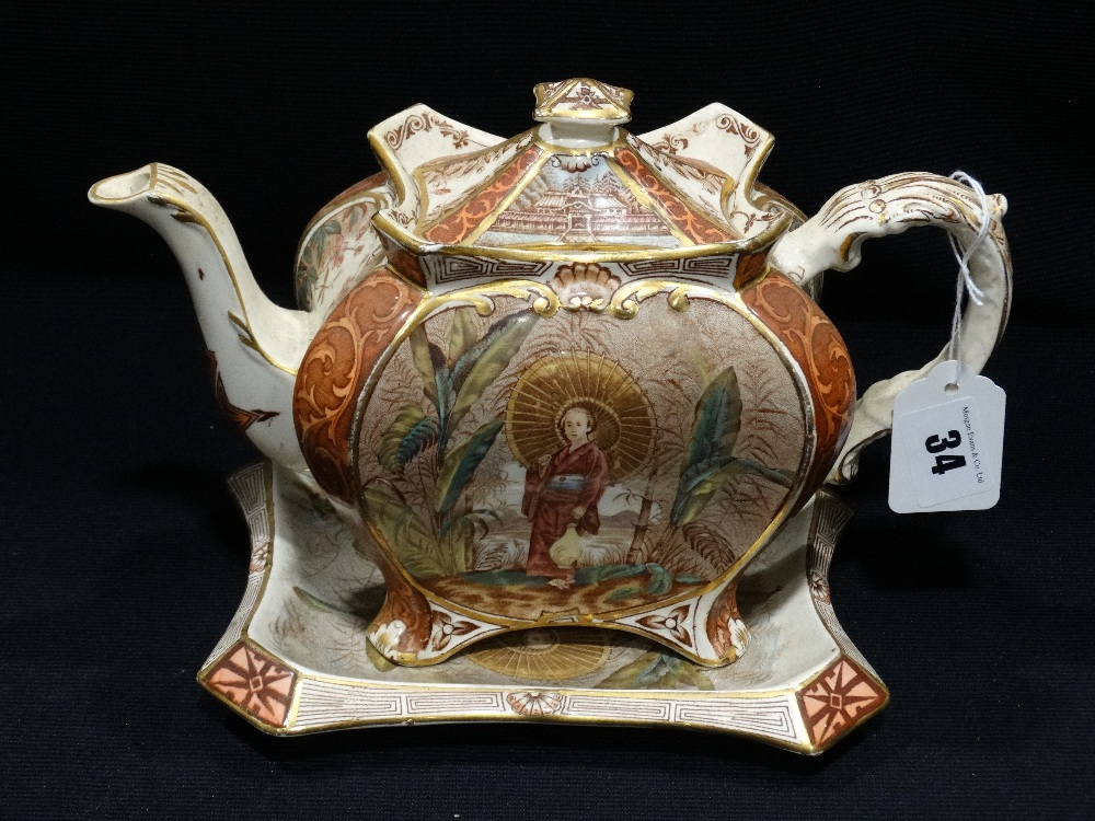 Lot 34 - A Staffordshire Pottery Oriental Transfer Decorated Teapot & Matching Stand