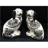 """A Pair Of Staffordshire Pottery Black & White Sponge Ware Decorated Seated Dogs, 9"""" High"""