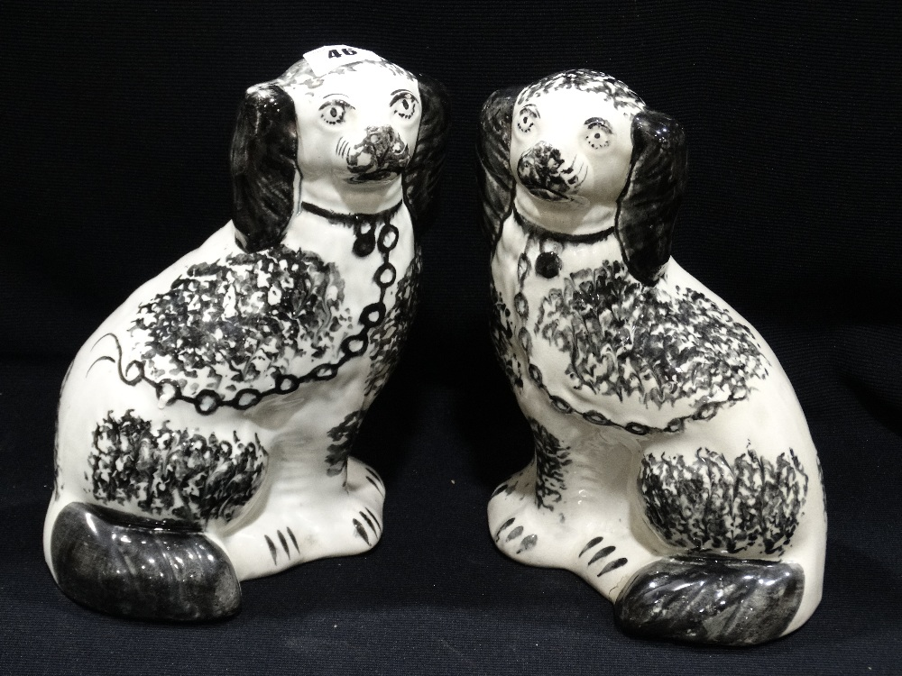 "Lot 46 - A Pair Of Staffordshire Pottery Black & White Sponge Ware Decorated Seated Dogs, 9"" High"