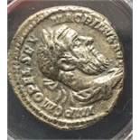 A silver denarius of Macrinus (AD 217-218) dating to c. AD 217-218. Obverse: IMP C M OPEL SEV