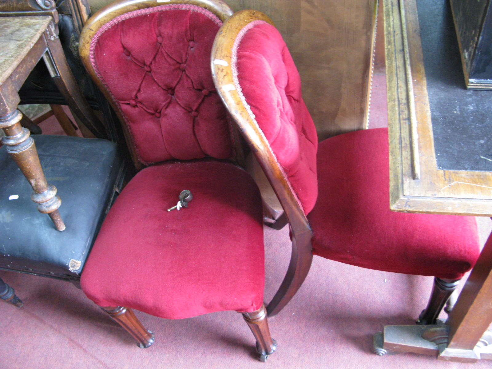 Lot 1506 - A Pair of XIX Century Mahogany Chairs, with upholstered backs and seats on reeded legs.