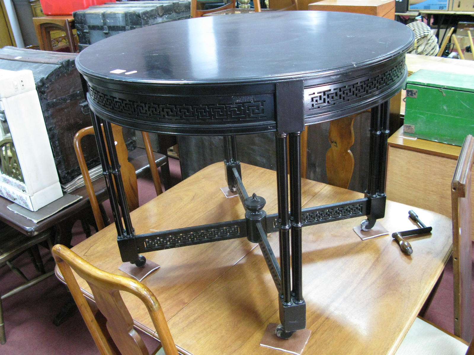 Lot 1502 - A Late XIX Century Ebonised Table, with circular top, bamboo pillared supports united by fretwork '