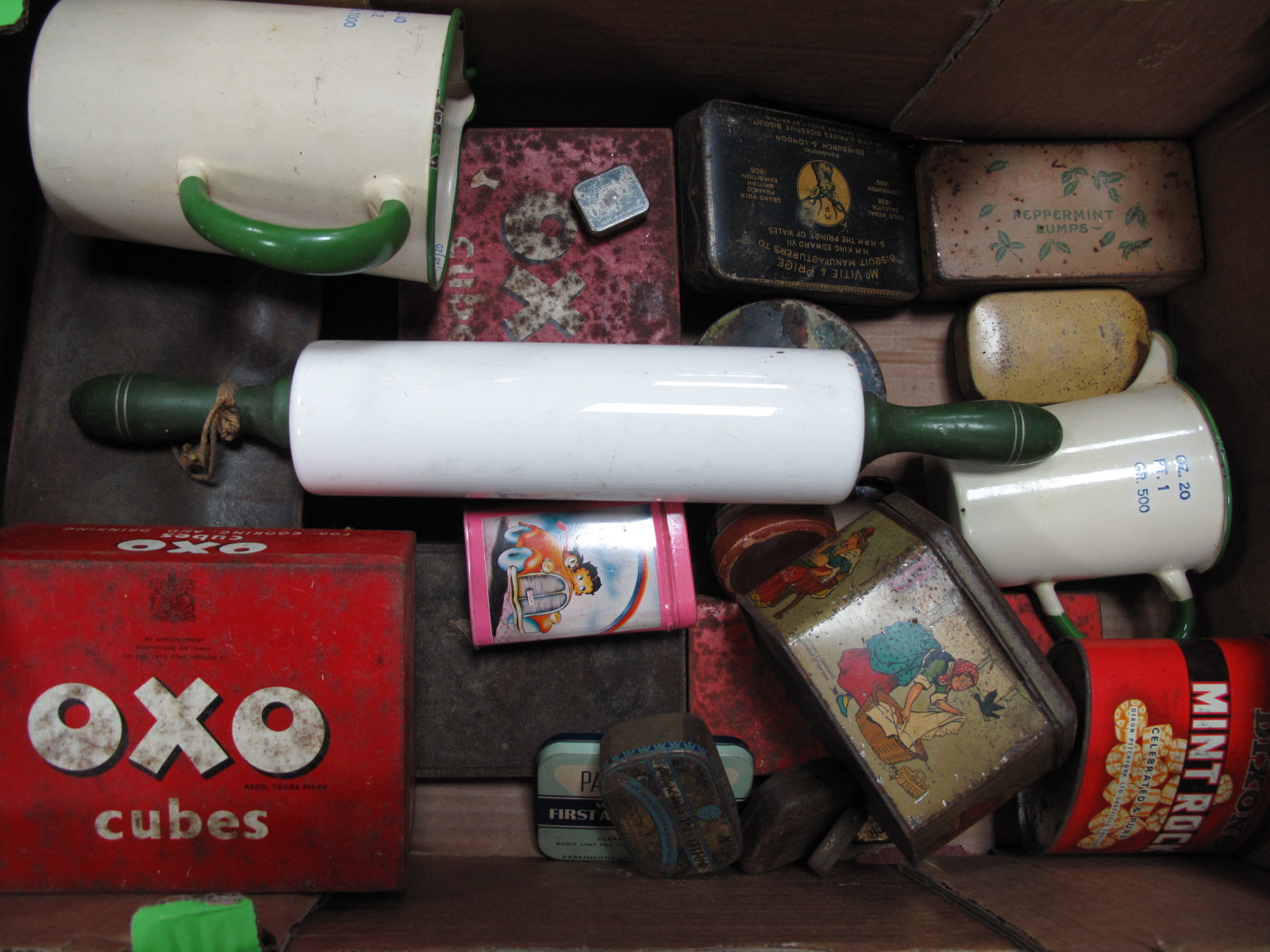 Lot 1060 - Tin Measuring Jugs, nut brown rolling pin, tin boxes, linens etc:- One Box