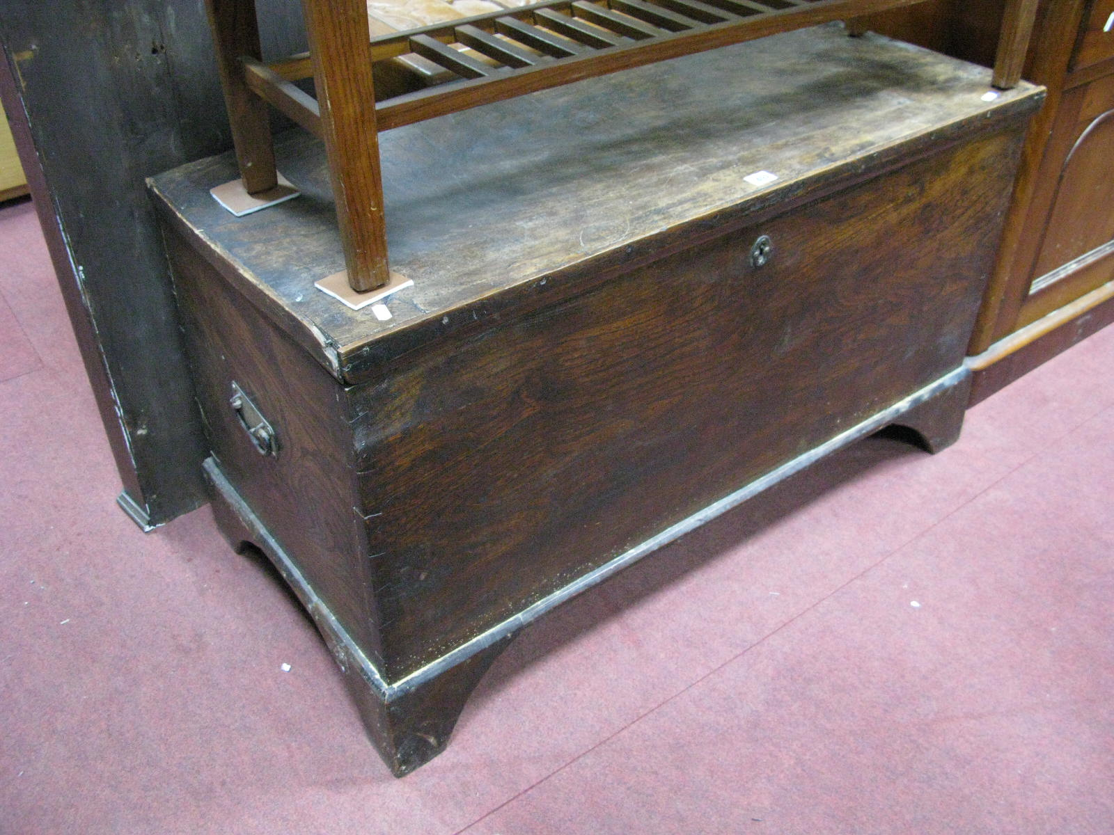 Lot 1492 - A XIX Century Elm Blanket Box, with hinged lid, on bracket feet.