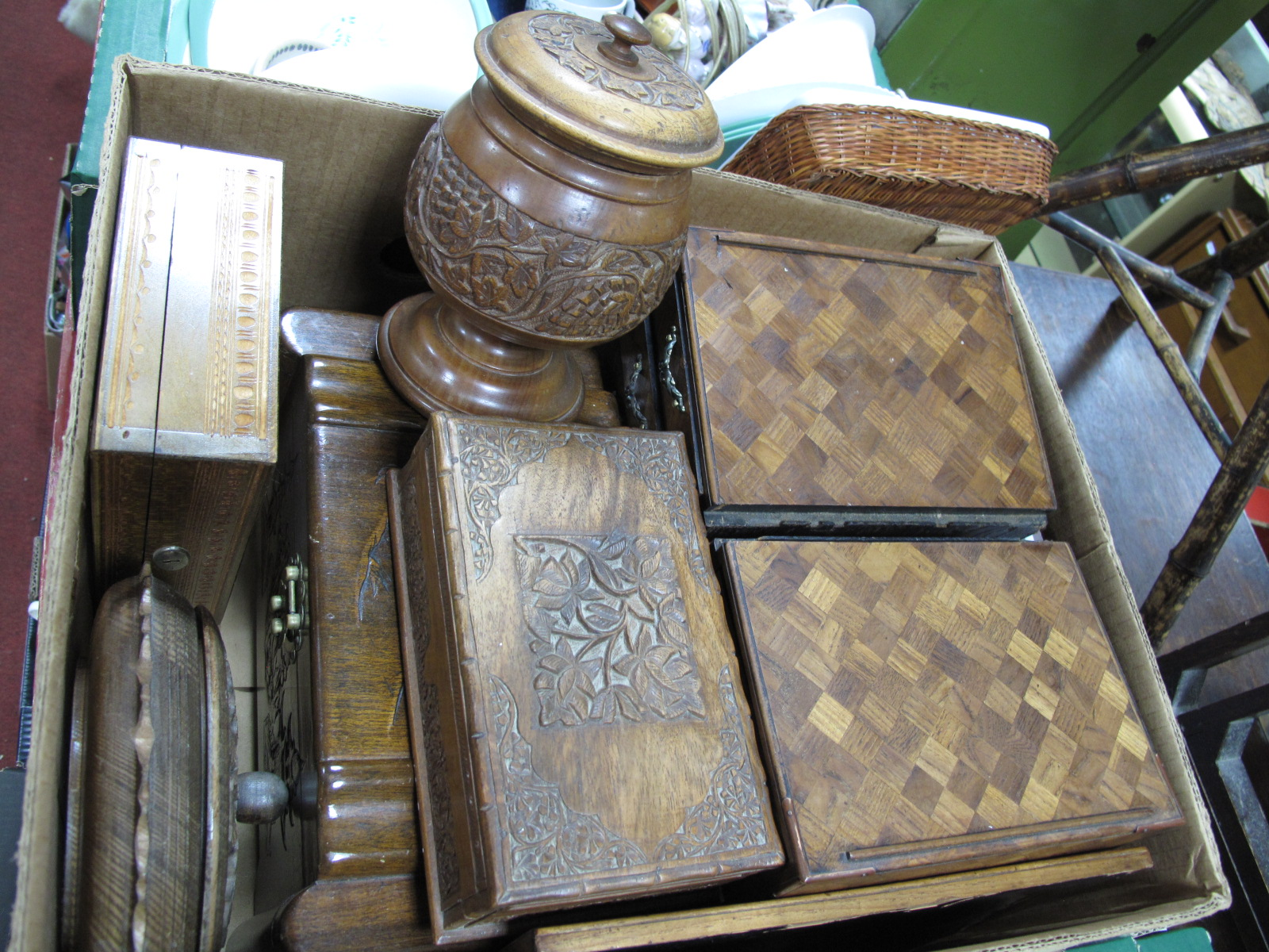 Lot 1055 - A South East Asian Carved Hardwood Box, a pair of mini chests, further hardwood boxes, bowl and