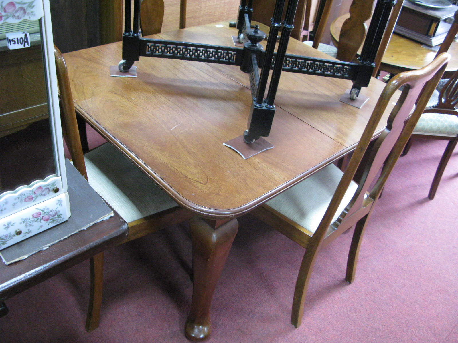 Lot 1509 - A 1920's Mahogany Extending Dining Table, with wind out action, spare leaf, on cabriole legs,