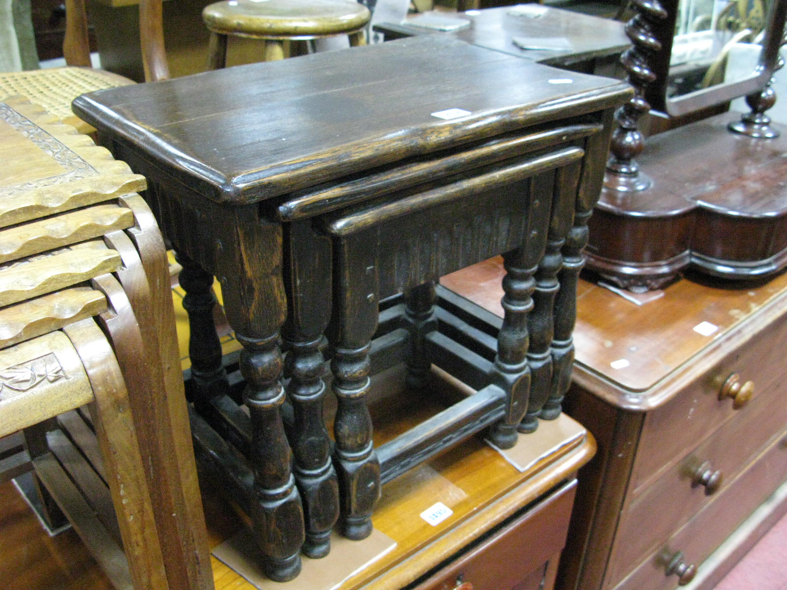 Lot 1494 - A Nest of Oak Coffee Tables, each with knulled apron, on turned and block supports.