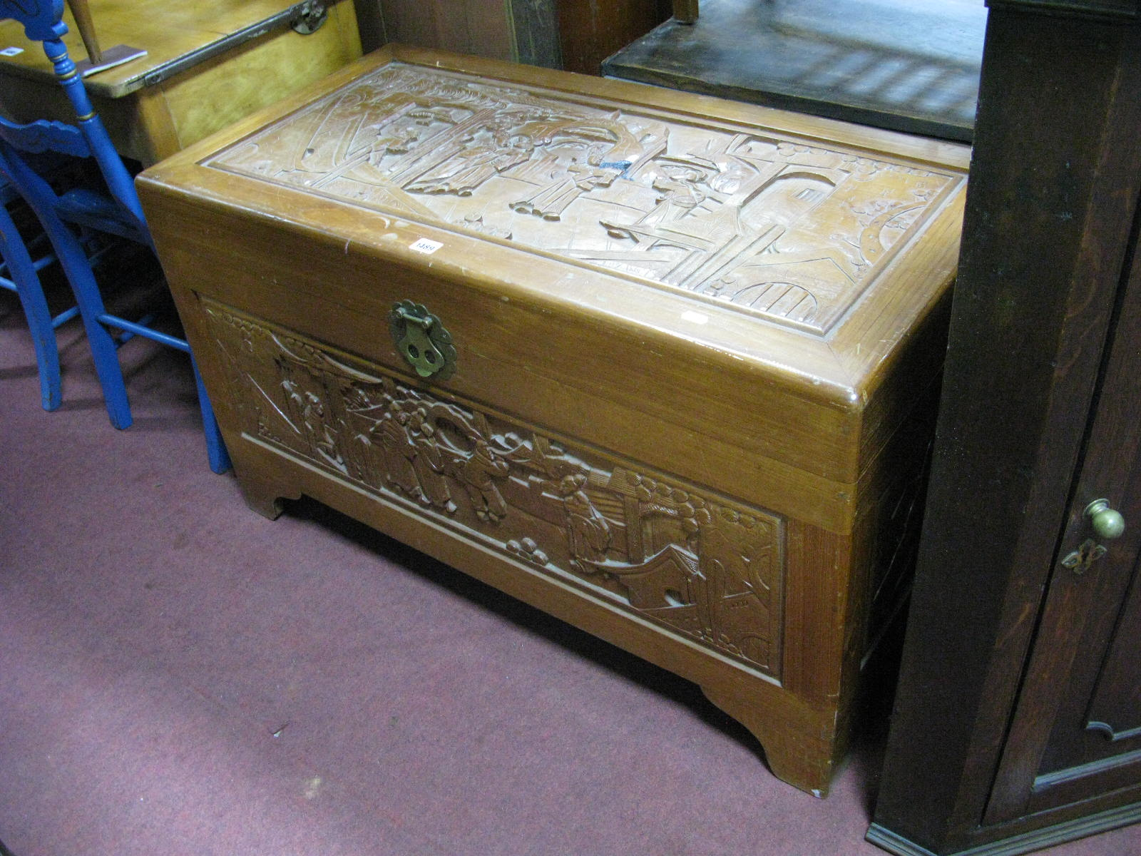 Lot 1489 - A Camphor Wood Oriental Chest, with carved panels.