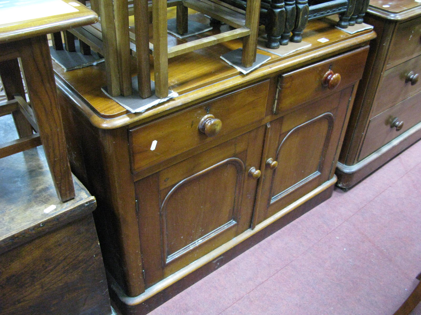 Lot 1495 - A XIX Century Mahogany Cupboard, with twin drawers over cupboard doors, curved corners on plinth