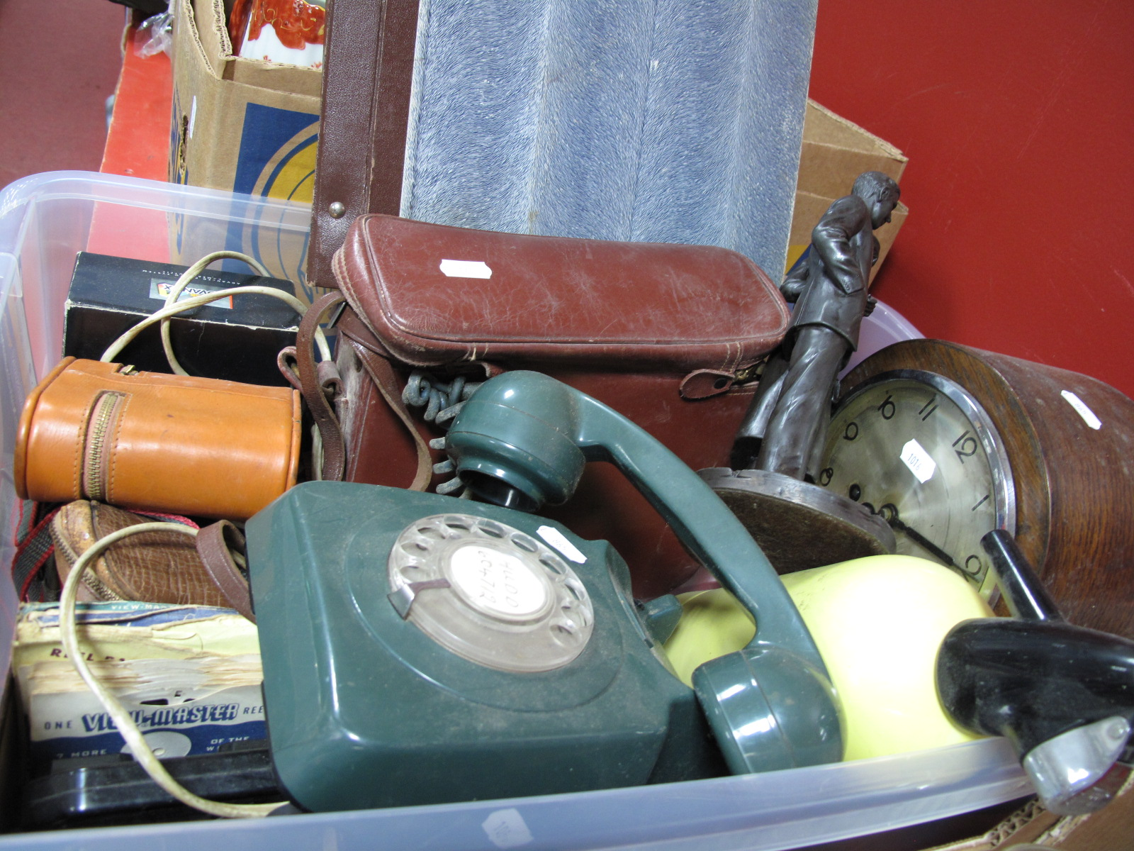 Lot 1015 - A Green Anvil Telephone, cameras, oak mantel clock, records, Charles & Diana figures etc:- One Box