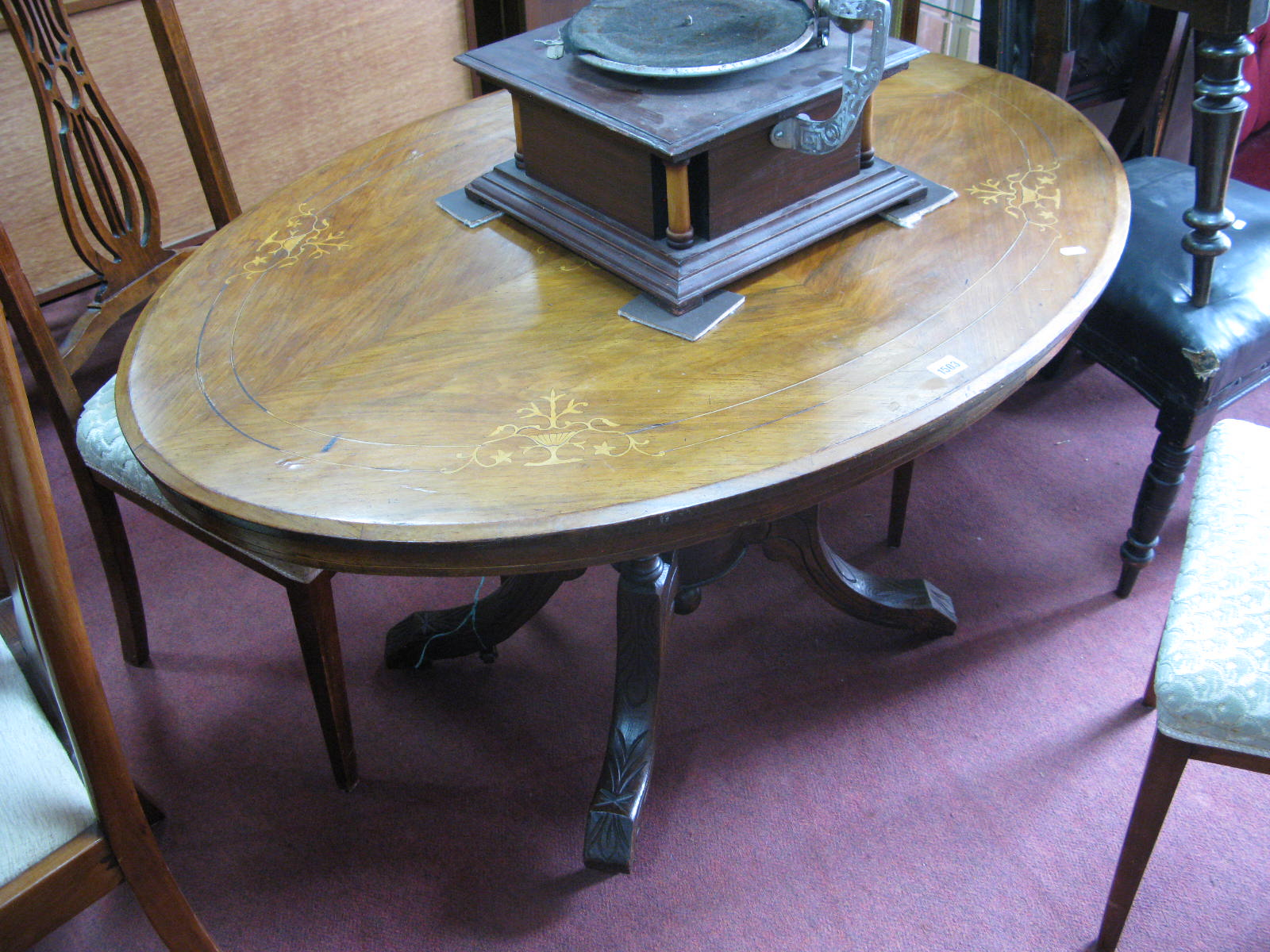 Lot 1503 - A XIX Century Walnut Loo Table, with satinwood vase inlay to oval top, on four pillar supports,