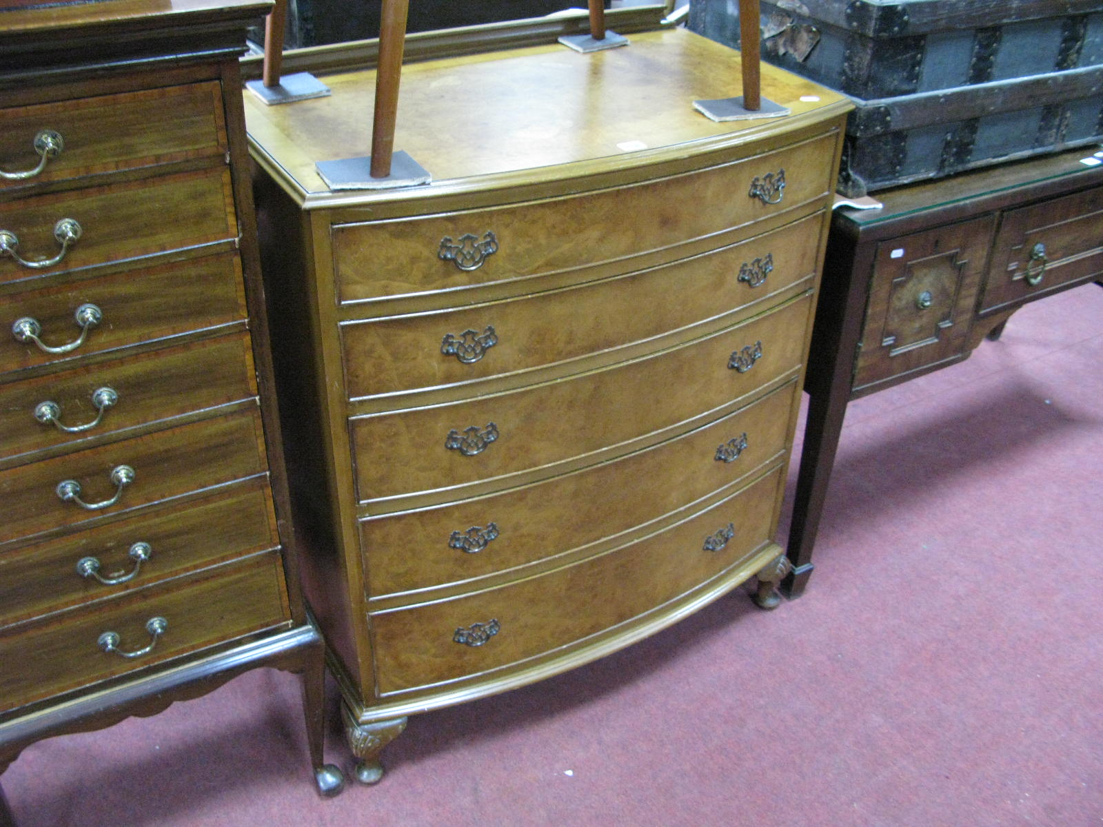 Lot 1516 - A Walnut Bow Fronted Chest of Drawers, with a low back, five graduated drawers, on cabriole legs.